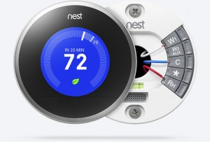 Touchscreen Nest Wifi thermostat with a blue display and text that reads 72 degrees