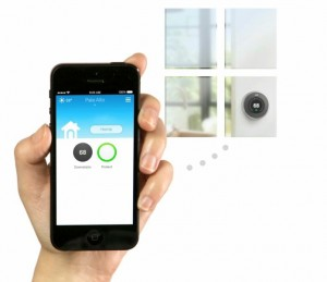 Hand holding an iPhone that is control the Wifi thermostat.