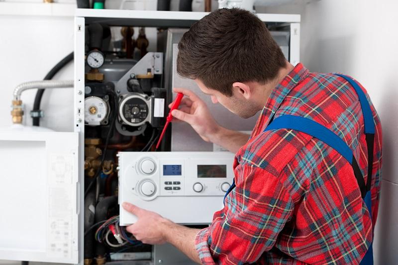 HVAC Technician repairing a HVAC system.