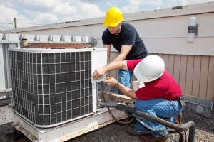 Two technicians repairing some dangerous HVAC problems.